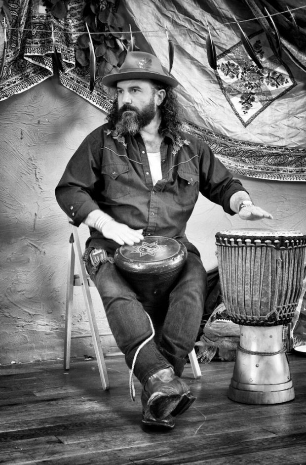 A different drum: Martin Shaw elling the Siberian tale of 'The Crow King and the Red Bead Woman' at Base Camp, Embercombe [Photo: Warren Draper]